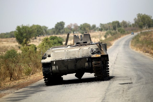 A military armoured tank is seen abandoned along a road after the Nigerian military recaptures the town of Michika from Boko Haram, Adamawa state May 10, 2015. (Photo by Akintunde Akinleye/Reuters)