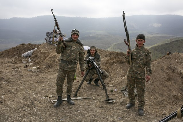 Armenian soldiers pose near a frontline in Nagorno-Karabakh, Azerbaijan, Wednesday, April 6, 2016. (Photo by Karo Sahakyan/PAN Photo via AP Photo)