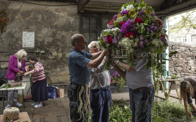 """The Garland nears completion during """"Castleton Garland Day"""" on May 29, 2019 in Castleton, England. (Photo by Dan Kitwood/Getty Images)"""