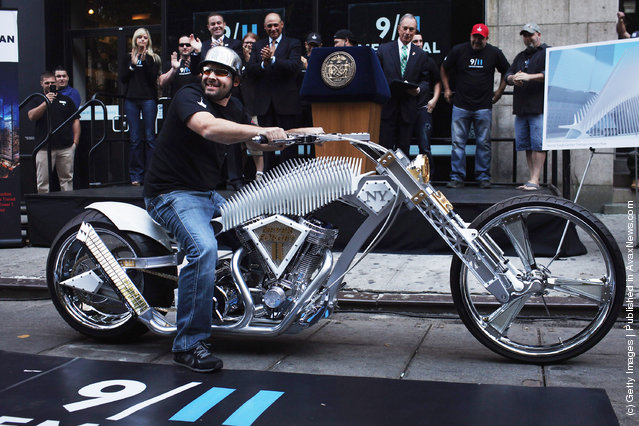 Paul Teutul Jr. of the television show American Chopper sits on a custom made World Trade Center inspired motorcycle in front of the 9/11 Memorial Preview Site