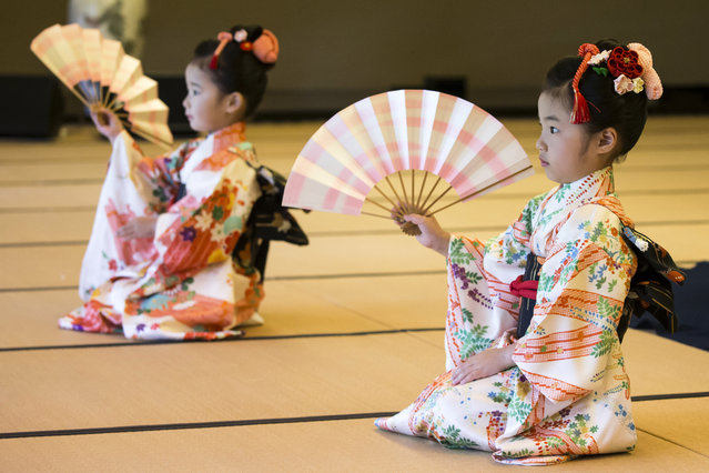 Children perform a traditional dance for U.S. first lady Melania Trump and Japanese Prime Minister Shinzo Abe's wife Akie Abe, both not pictured, during a cultural event at the Japanese style annex inside the State Guest House  in Tokyo Monday, May 27, 2019. (Photo by Tomohiro Ohsumi/Pool Photo via AP Photo)