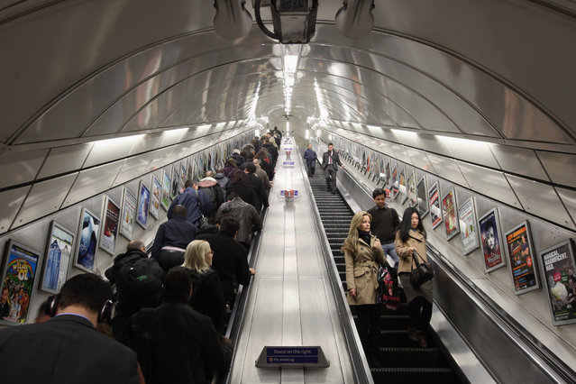 Commuters make their way on the escalator at Angel underground station on March 5, 2012 in London, England.  The escalators at Angel tube station are the longest escalators on the tube network. London's underground rail system, commonly called the tube, is the oldest of its kind in the world dating back to 1890. It carries approximately a quarter of a million people around its network every day along its 249 miles of track and 270 stations. (Photo by Dan Kitwood/Getty Images)