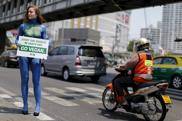 A PETA (People for the Ethical Treatment of Animals) activist with her body painted promotes veganism in Bangkok April 21, 2016. (Photo by Jorge Silva/Reuters)