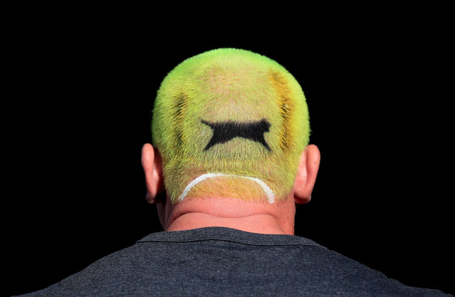 A tennis fan with a Slazenger ball dyed into his hair on day one of the Wimbledon Championships at the All England Lawn Tennis and Croquet Club, Wimbledon on July 1, 2019. (Photo by Mike Egerton/PA Images via Getty Images)