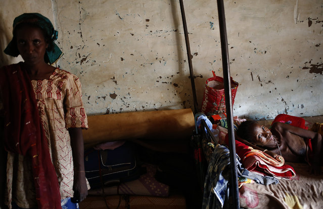 A sick internally displaced Muslim woman lies in a house in the town of Boda April 15, 2014. (Photo by Goran Tomasevic/Reuters)