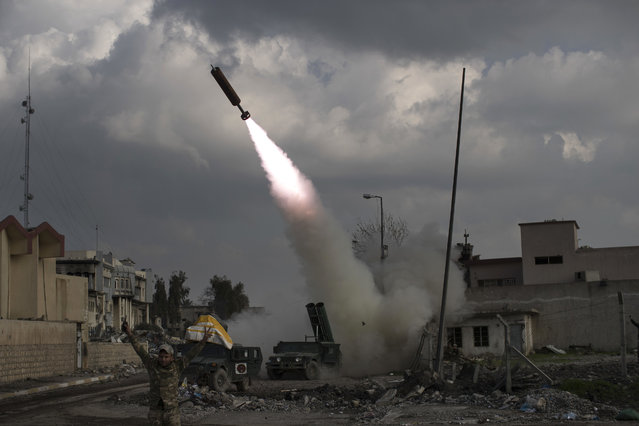 Federal Police Rapid Response Forces fire a rocket towards Islamic State positions near the old city, in Mosul, Iraq, Monday, March 20, 2017. (Photo by Felipe Dana/AP Photo)