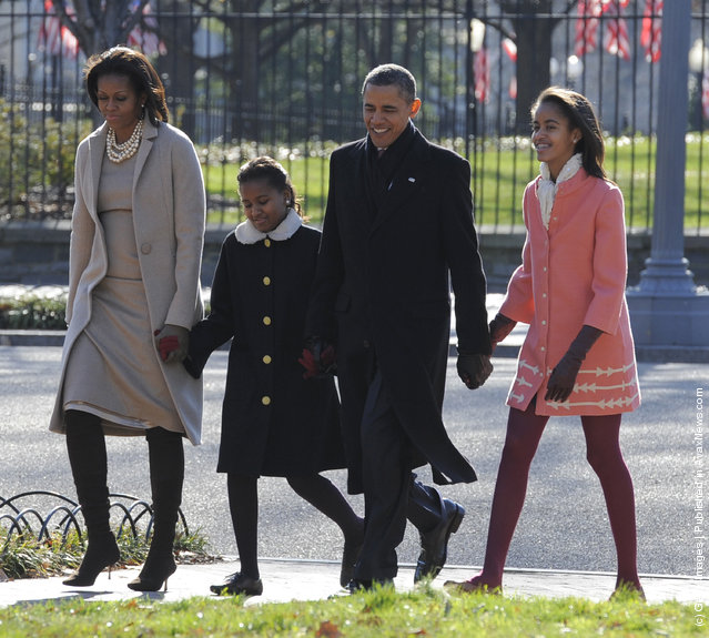 U.S. President Barack Obama, first lady Michelle Obama (L) and daughters Malia Obama (R) and Sasha Obama (2L) walk from the White House across Lafayette Park to St. John's Church for Sunday services December 11, 2011 in Washington, DC