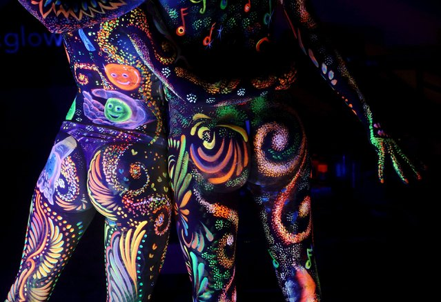 Models display ultraviolet light paint during the annual World Bodypainting Festival in Poertschach, Austria, July 3, 2015. (Photo by Heinz-Peter Bader/Reuters)