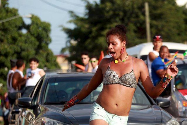 A reveller dances during a gay pride parade in Santo Domingo in the Dominican Republic July 5, 2015. (Photo by Ricardo Rojas/Reuters)