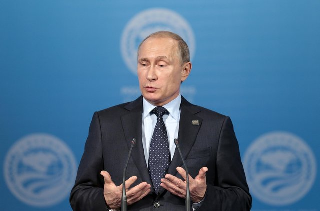 Russian President Vladimir Putin speaks at a news conference after the Shanghai Cooperation Organization (SCO) summit in Ufa, Russia, Friday, July 10, 2015.  President Vladimir Putin announced Friday that India and Pakistan will join the Shanghai Cooperation Organization, a group dominated by Russia and China and also including former Soviet republics in Central Asia. (Photo by Ivan Sekretarev/AP Photo)