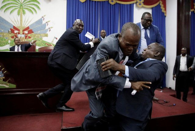 Deputies argue before a session to present the general policy of the appointed Prime Minister Fritz William Michel at the Parliament in Port-au-Prince, Haiti, September 3, 2019. (Photo by Andres Martinez Casares/Reuters)
