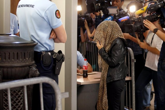 "A woman arrives to attend the ruling in the case of 14 members of a banned Islamic group tried on charges of ""criminal conspiracy related to a terrorist enterprise"" at the Paris court house, France, July 10, 2015.The leader of a banned French group, Mohamed Achamlane, was sentenced to nine years in jail on Friday on terrorism charges after police raids found weapons and a list of Jewish targets in his personal files. (Photo by Charles Platiau/Reuters)"