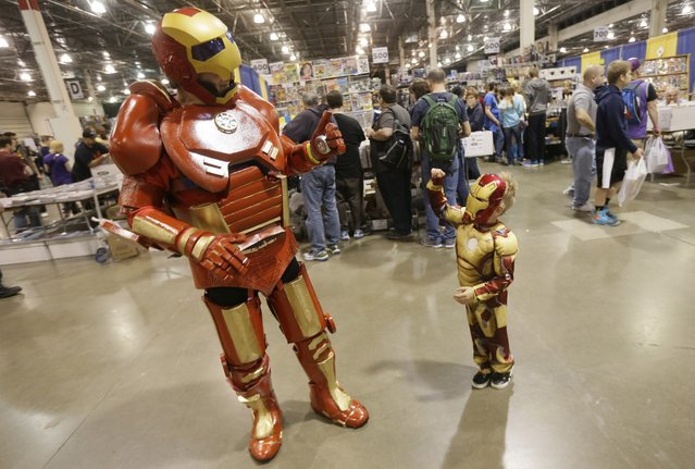 Dave Gwin, left, dressed as Iron Man meets with Ely at the Motor City Comic Con, Friday, May 13, 2016 in Novi, Mich. (Photo by Carlos Osorio/AP Photo)
