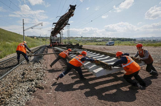 A services brigade of the Russian Railways replaces rail tracks of the Trans-Siberian Railway outside the Siberian city of Krasnoyarsk, Russia, July 13, 2015. (Photo by Ilya Naymushin/Reuters)