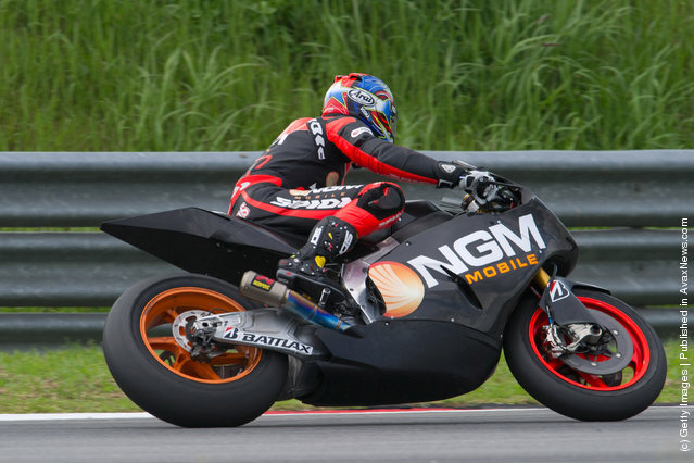 Colin Edwards of USA and NGM Mobile Forward Racing rounds the bend during the third day of MotoGP testing at Sepang Circuit