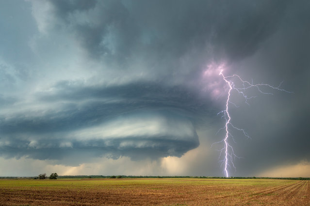 """The Supercell"". This shortlisted image by Dennis Oswald Huge farmland of was taken in south-west Oklahoma, US. (Photo by Dennis Oswald/2019 Weather Photographer of the Year/RMetS)"