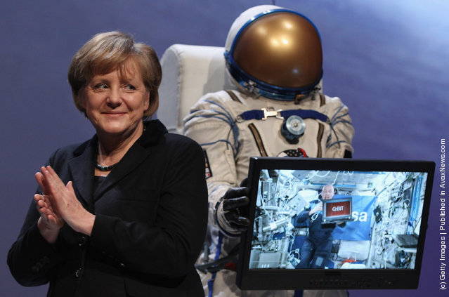 German Chancellor Angela Merkel smiles during a live hook-up with astronaut Andre Kuipers on the ISS space station at the opening ceremony of the CeBIT 2012 technology trade fair on March 5, 2012 in Hanover, Germany