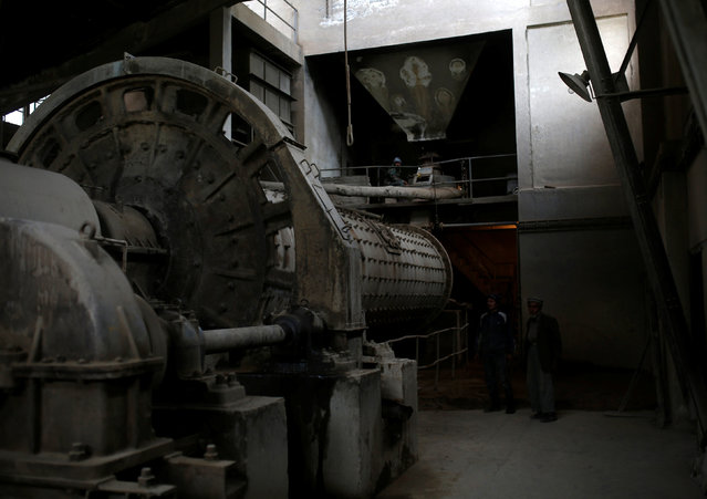 Workers operate heavy machinery at the Jabal Saraj cement factory in Jabal Saraj, north of Kabul, Afghanistan April 19, 2016. (Photo by Ahmad Masood/Reuters)