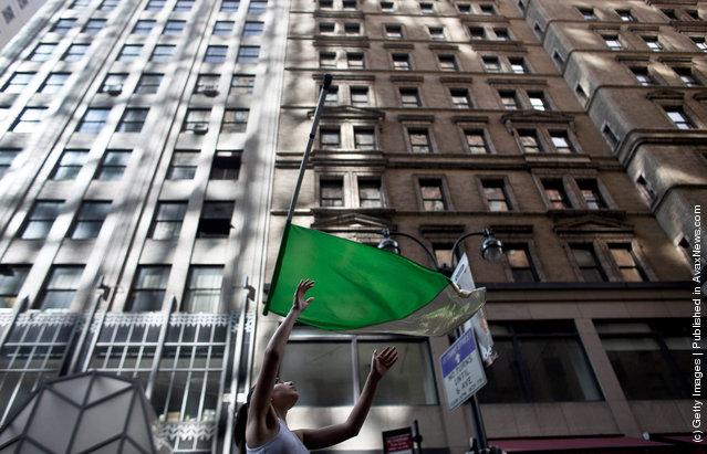 A woman throws a flag while marching during the 251st annual St. Patrick's Day Parade March 17, 2012 in New York City