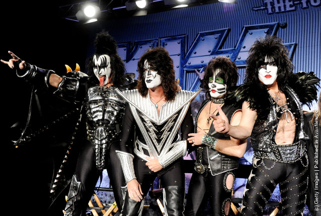 (L-R) Musicians Gene Simmons, Tommy Thayer, Eric Singer and Paul Stanley appear onstage to announce their upcoming Motley Crue and KISS co-headlining tour at the Hollywood Roosevelt Hotel