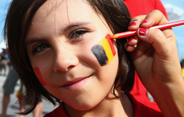 A young Belgium fan is face painted prior to the 2014 FIFA World Cup Brazil Group H match between Belgium and Algeria at Estadio Mineirao on June 17, 2014 in Belo Horizonte, Brazil. (Photo by Ian Walton/Getty Images)