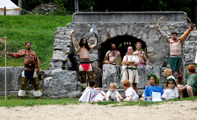 "Members of the ""Familia Gladiatoria Carnuntina"" arrive for a fight in the historic amphitheatre during the Roman Festival at the archeological site of Carnuntum in Petronell, Austria, June 11, 2016. (Photo by Leonhard Foeger/Reuters)"