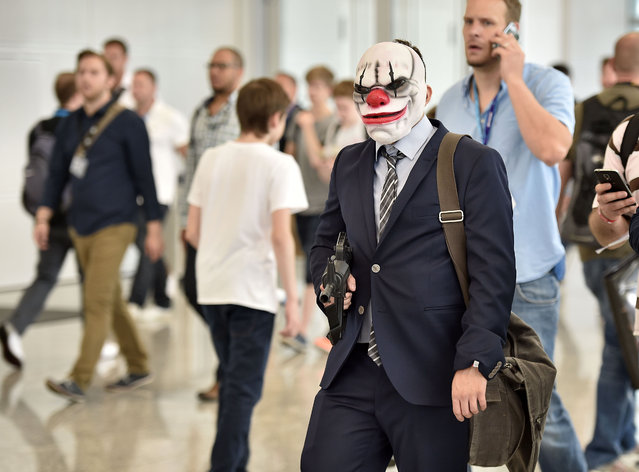 A  costumed participant arrives at the gamescom  fair in Cologne, Germany, Wednesday, August 5, 2015. (Photo by Martin Meissner/AP Photo)