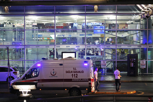 Turkish rescue services gather outside Istanbul's Ataturk airport, Tuesday, June 28, 2016. (Photo by Emrah Gurel/AP Photo)