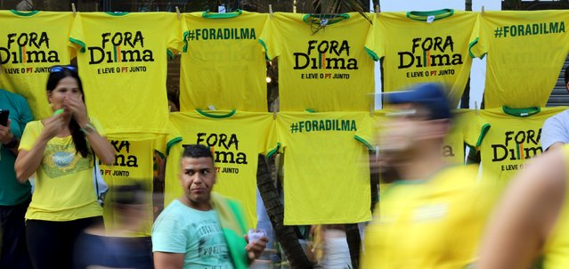 "Demonstrators walk past shirts that read, ""Out Dilma"", during a protest against Brazil's President Dilma Rousseff, part of nationwide protests calling for her impeachment, at Paulista Avenue in Sao Paulo's financial centre, Brazil, August 16, 2015. (Photo by Paulo Whitaker/Reuters)"