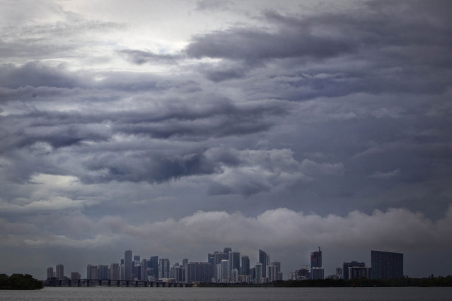 The Miami skyline is pictured from a causeway on a rainy day in Miami, July 21, 2014. (Photo by Carlo Allegri/Reuters)