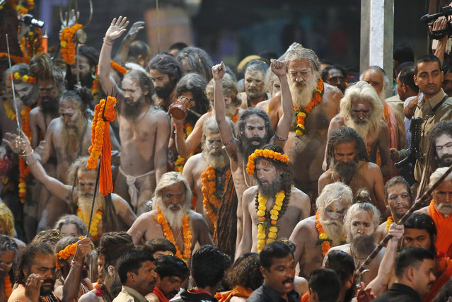 Naked Hindu holy men prepare to bath in the Godavari River during Kumbh Mela, or Pitcher Festival, at Trimbakeshwar in Nasik, India, August 29, 2015. (Photo by Rajanish Kakade/AP Photo)