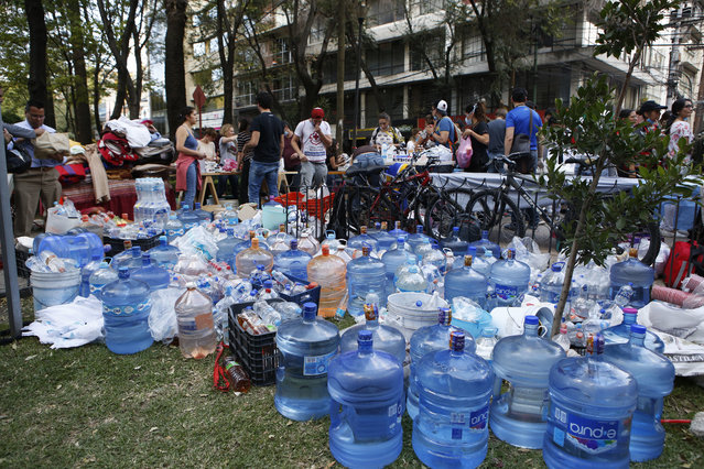 Volunteers gather water, medicine, and blankets donated by neighborhood residents in the Condesa neighborhood of Mexico City, Tuesday, September 19, 2017. (Photo by Rebecca Blackwell/AP Photo)