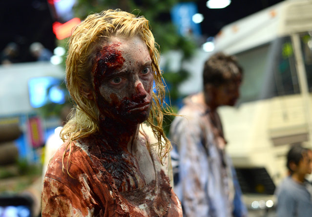 A fan dresses as a zombie on day 3 of Comic-Con International on Saturday, July 23, 2016, in San Diego. (Photo by Al Powers/Invision/AP Photo)