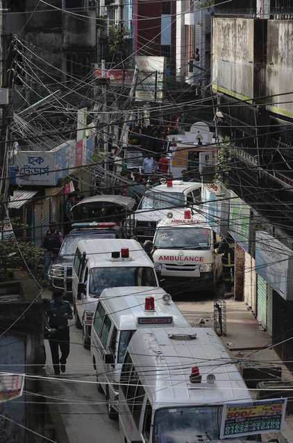 Ambulances carrying bodies of killed suspected Islamic militants leave the premises of a five-story building that was raided by police in Dhaka, Bangladesh, Tuesday, July 26, 2016. (Photo by AP Photo)