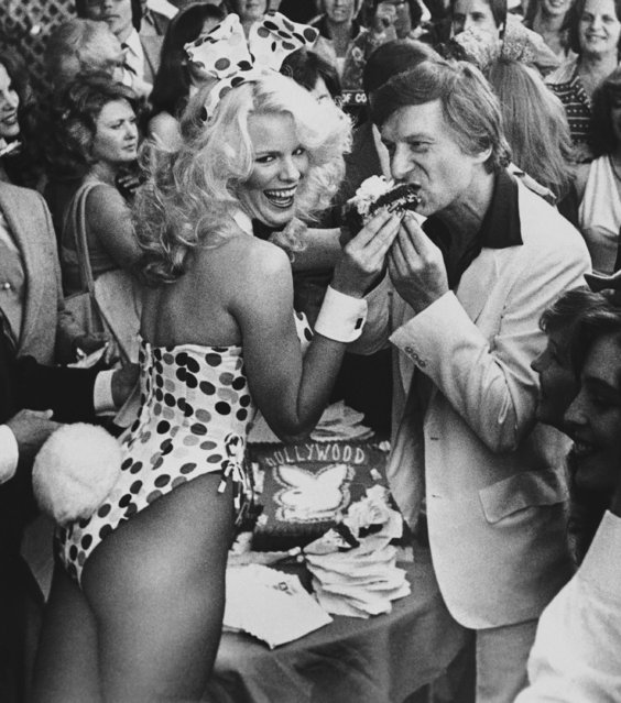 Bunny Betsy, left, feeds Hugh Hefner, right, a piece of congratulatory cake after he was awarded the 1,716th star in the Hollywood walk of fame, Wednesday, April 9, 1980, Los Angeles, Calif. Hefner, chairman of the board, Playboy Enterprises Inc. started Playboy Magazine in 1953 with an investment of $600. (Photo by AP Photo/Loundy)