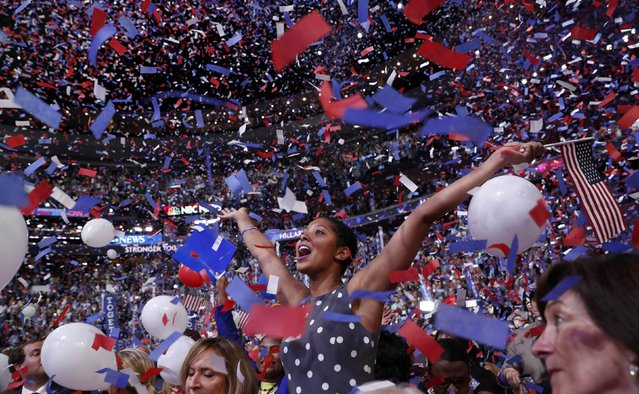 A delegate in the crowd celebrates amidst confetti and balloons after Democratic presidential nominee Hillary Clinton accepted the nomination on the fourth and final night at the Democratic National Convention in Philadelphia, Pennsylvania, U.S. July 28, 2016. (Photo by Mark Kauzlarich/Reuters)
