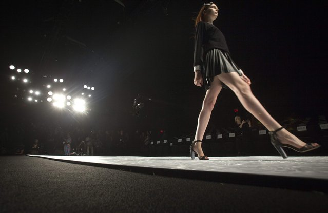 A model does a practice run before the Monique Lhuillier Spring/Summer 2015 runway show during New York Fashion Week in the Manhattan borough of New York September 5, 2014. (Photo by Carlo Allegri/Reuters)