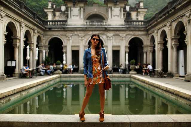 """Maria Callou, a 35-year-old fashion designer, poses for a portrait in Rio de Janeiro, Brazil, June 30, 2016. When asked what she felt about Rio de Janeiro hosting the Olympics, Maria said, """"I am glad about the Olympics and I think the problems of the country, such as corruption and violence, will go unnoticed during the event. We are hospitable people and we know how to bring joy and happiness to tourists"""". (Photo by Pilar Olivares/Reuters)"""