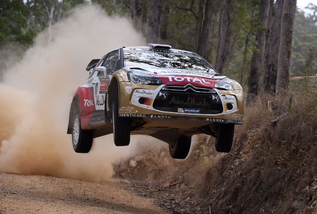 British rally driver Kris Meeke jumps his Citroen over a brow during the fifth special stage of the World Rally Championship (WRC) Rally of Australia, near Bellingen on the New South Wales central coast on September 12, 2014. (Photo by William West/AFP Photo)