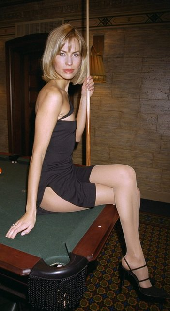 "Anna Malova, Miss Russia 1998, poses on a pool table at The Campbell Apartment restaurant in Grand Central Station on November 18, 1999. She makes her motion picture debut in the movie ""Above Ground"". (Photo by Richard Corkery/NY Daily News Archive via Getty Images)"