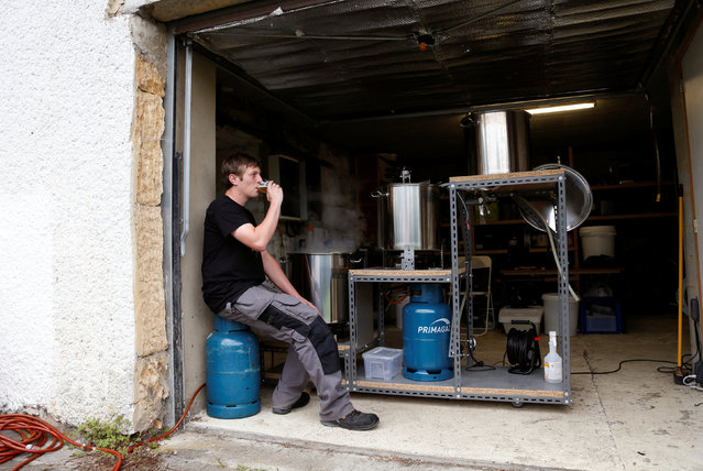 Arnaud Laloy, member of the Belgian Homebrewers association, tastes his own beer as he brews in the garage of his house in Neufchateau, Belgium, August 11, 2016. (Photo by Francois Lenoir/Reuters)