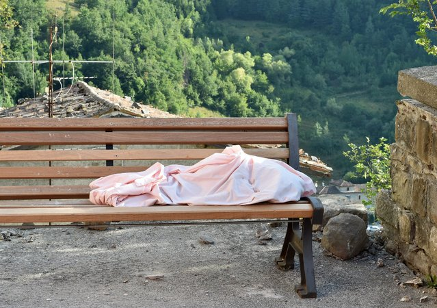 The body of an unidentifeid child lies on a bench on August 24, 2016 in Arquata del Tronto, Italy. Central Italy was struck by a powerful, 6.2-magnitude earthquake in the early hours, which has killed at least thirteen people and devastated dozens of mountain villages. Numerous buildings have collapsed in communities close to the epicenter of the quake near the town of Norcia in the region of Umbria, witnesses have told Italian media, with an increase in the death toll highly likely (Photo by Giuseppe Bellini/Getty Images)