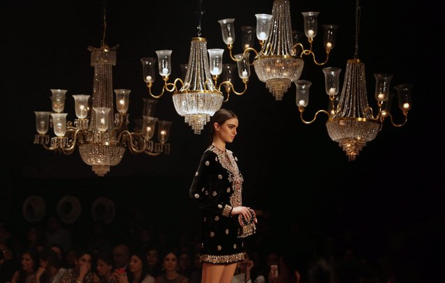 A model presents a creation by Indian designer, Sabyasachi Mukherjee during the Grand Finale of Lakme Fashion Week (LFW) Winter/Festive 2016 in Mumbai, India, 28 August 2016. (Photo by Divyakant Solanki/EPA)