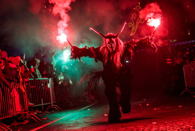 A man dressed as a devil performs during a Krampus parade in Kaprun, Austria on December 5, 2017. Krampus is a mythical creature that, according to legend, accompanies Saint Nicholas during the festive season. Instead of giving gifts to good children, he punishes the bad ones. (Photo by APA-PictureDesk GmbH/Rex Features/Shutterstock)