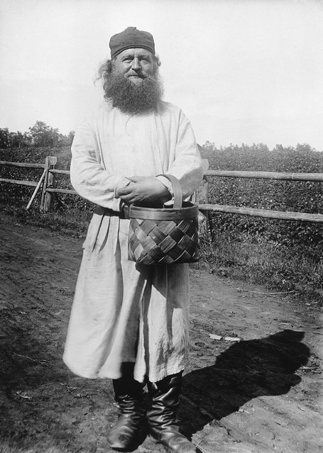 Priest, Valamo Monastery, Karelia, Russia (then Finland), 1930s. Father Venerius with a birchbark basket. (Photo by Einar Erici)