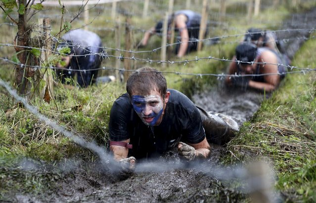 People take part in an extreme run competition in Zhodino, east of Minsk, September 26, 2015. (Photo by Vasily Fedosenko/Reuters)