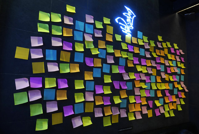 "A Hong Kong Cafe, known as a ""yellow shop"" because its owners expressed sympathy for protesters, has a wall decorated with blank post-it notes in Hong Kong Thursday, July 9, 2020. Stores that supported the protest movement by putting up protest artwork and sticky notes filled with words of encouragement from customers have since taken them down, out of fear that its contents could land them in trouble with the authorities. Instead, they have put up blank sticky notes as a way to show solidarity with the movement. (Photo by Vincent Yu/AP Photo)"