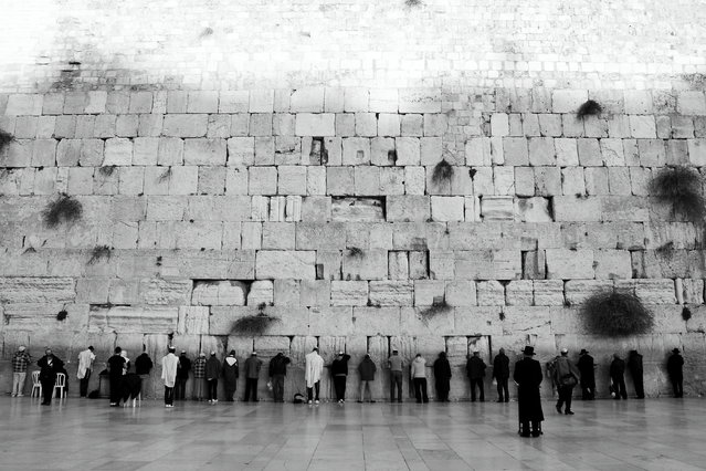 """""""Western Wall"""". Western Wall symbolise the root of Jewish, the last parts of the wall are remnants of the ancient wall that surrounded the Jewish Temple's courtyard. Herod the Great builded western well around 19 BC. Now here is Jewish holy centre. Jew come and pray for tiny peace in this unstable world. Photo location: Jerusalem, Israel. (Photo and caption by Everflood Xie/National Geographic Photo Contest)"""
