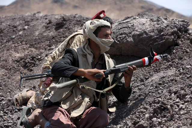 A tribal fighter loyal to Yemen's government squats on the side on a slope at the frontline of fighting against Houthi militants in the central province of Marib October 7, 2015. (Photo by Reuters/Stringer)