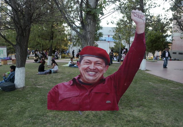 A image of Venezuela's late President Hugo Chavez is displayed outside of the World People's Conference on Climate Change and the Defense of Life, ahead of next month's World Climate Change Conference in France, in Tiquipaya, Bolivia, October 10, 2015. (Photo by David Mercado/Reuters)